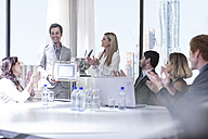 Successful business people celebrating awards in boardroom - ZEF008012