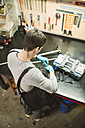 Young mechanic working in repair garage - RAEF000790
