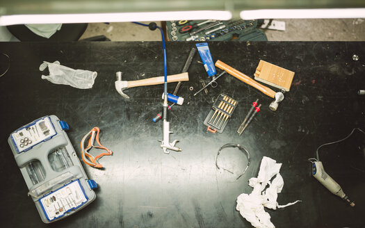 Tools on work bench in repair workshop, close up - RAEF000805