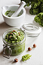 Preserving jar of vegan kale pesto with hazelnuts - EVGF002779