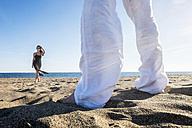 Spain, Tenerife, couple relaxing on the beach - SIPF000134