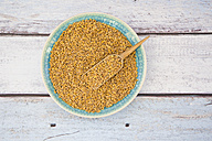 Bowl of organic einkorn wheat on wood - LVF004470