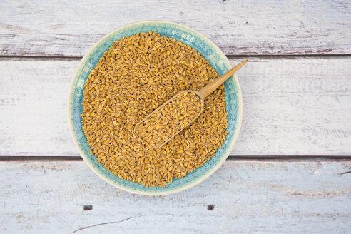 Bowl of organic einkorn wheat on wood - LVF004470