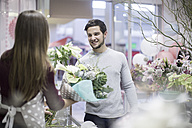 Man buying flowers in flower shop - ZEF008123