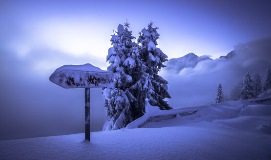Germany, Bavaria, Berchtesgaden Alps, snowy landscape, sign on Rossfeld - STCF000153