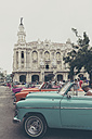 Cuba, Havana, view to Great Theatre of Havana with parked vintage cars in the foreground - MAB000360