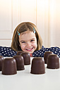 Portrait of happy girl with chocolate marshmallows - LVF004485