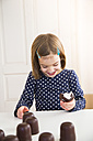Little girl eating chocolate marshmallow - LVF004488