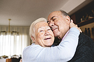 Affectionate senior couple hugging at home - GEMF000672