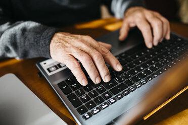 Hands of senior man using laptop, close-up - JRFF000364