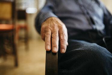Hand of senior man on armrest - JRFF000385