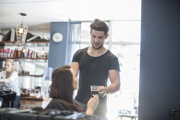 Woman in hair salon receiving cup of coffee - ZEF008201