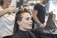 Woman in hair salon getting her hair done - ZEF008204