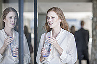 Young business woman drinking water - ZEF008228