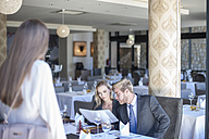 Young business people meeting in restaurant for lunch - ZEF008246