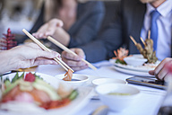 Business people having lunch at restaurant - ZEF008255
