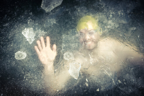 Germany, Burghausen, portrait of smiling man under water at frozen Woehrsee - HAMF000137