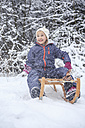 Portrait of girl sledging in the forest - VTF000497