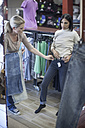 Woman trying on jeans in clothing shop - ZEF008295