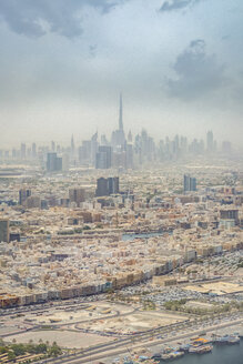Dubai, Aerial view of Deira and Bur Dubai with the creek and the skyline of downtown, with Burj Khalifa in the distance - NKF000442