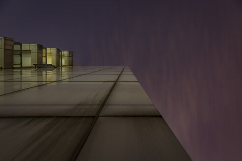 China, Shanghai, worm's eye view of a residential highrise at night - NKF000452