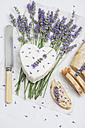 French cow's milk cheese, heart-shaped, lavender blossom, baguette on serviette - GWF004588