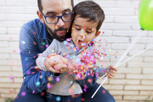 Father and his little son blowing confetti - VABF000114