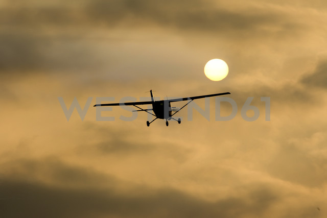 Germany, Hesse, Sports plane Cessna 152 in the evening - AMF004732