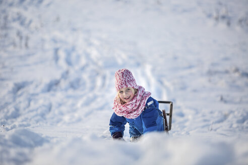 Portrait of smiling girl girl with sledge in the snow - ASCF000476