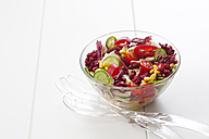 Glass bowl of mixed salad on white ground - CSF027073
