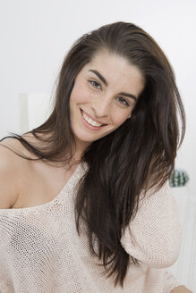 Portrait of smiling young woman with long brown hair - GDF000967
