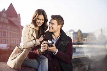Germany, Berlin, young couple looking at camera at bank of River Spree - GCF000140