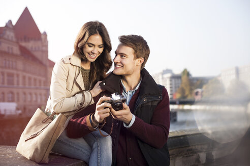 Germany, Berlin, young couple looking at camera at bank of River Spree - GCF000140