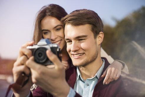 Young couple looking at camera - GCF000143
