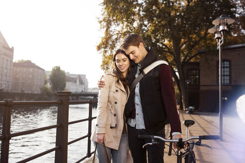 Germany, Berlin, young couple hugging at River Spree - GCF000158