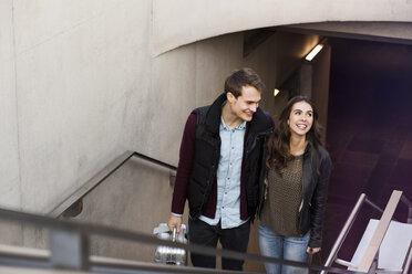 Germany, Berlin, smiling couple leaving underground station - GCF000185