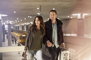 Germany, Berlin, smiling couple leaving underground station - GC000188