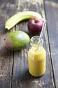 Glass bottle of mango smoothie - SARF002518