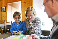 Grandparents playing ludo their grandson - VABF000117