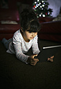 Little girl using digital tablet at home - MGOF001330