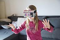 Fumbling girl with Virtual Reality Glasses - SARF002528