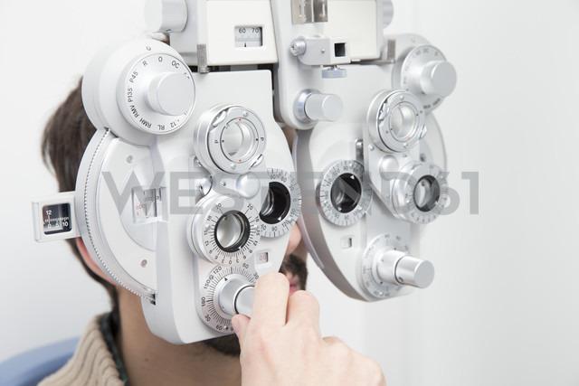 Man at the optometrist making an eye test - ERLF000122