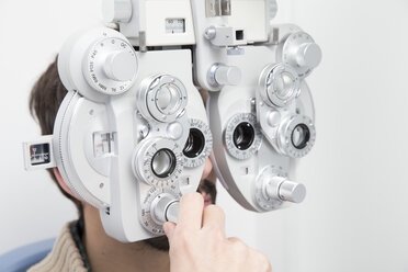 Man at the optometrist making an eye test - ERLF000122