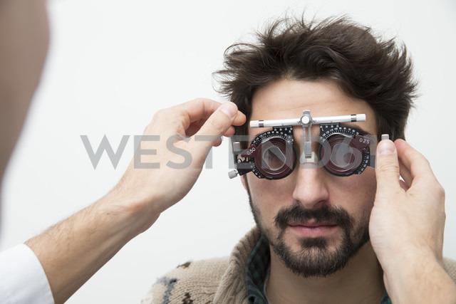 Man at the optometrist making an eye test - ERLF000125