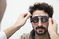 Man at the optometrist making an eye test - ERLF000125