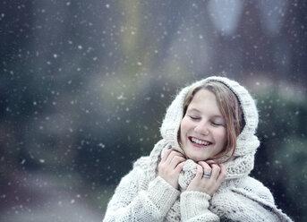Portrait of happy young woman wearing knitwear in winter - NIF000076