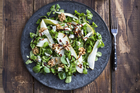 Lamb's lettuce with pear, gorgonzola and walnut on plate, fork - SARF002533