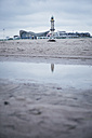 Germany, Warnemuende, restaurant and lighthouse on beach - ASCF000510