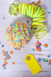 Bismarck Doughnut with sugar confetti, streamer and yellow tag - ODF001367
