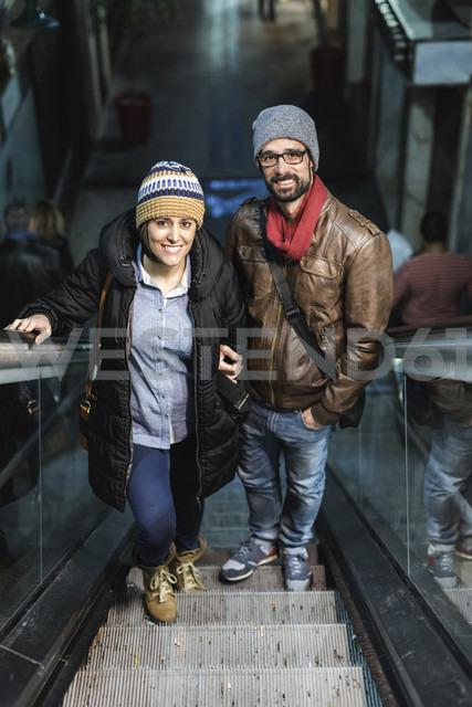Portrait of couple on escalator - JASF000377